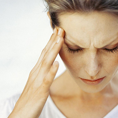 Lady with Headache, Migraine, Chiropractor Belfast